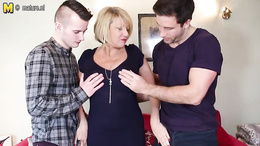 Shorthaired mature granny takes on two young stiff cocks on the sofa