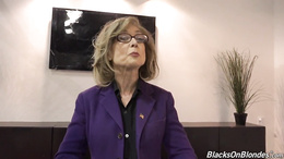 Mature Nina Hartley takes good care of two massive black cocks
