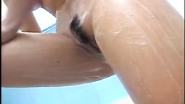 Asian brunette taking a shower and has nice boobs