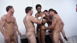 Ebony with big boobs enjoys white guys in a row during top group show