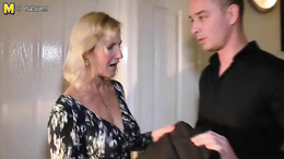 Blonde busty milf giving this handsome bloke some superb head