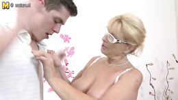 MAture granny with big boobs gives her young lover a steamy blowjob
