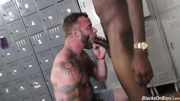 Tattoed stud gets his tight white ass banged by a big black cock
