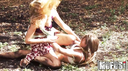 Lesbian sluts get dirty outdoor in the grass the takes cock in mouth