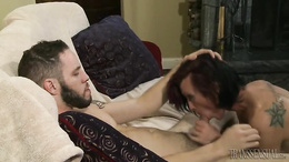 Tattooed tranny blows the stiff wood in sloppy modes and with passion