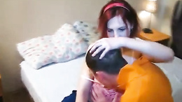 Beautiful redhead chick sucks boyfriend's hard cock before riding him