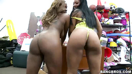 Two chocolate babes show off their big booties