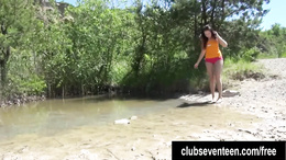 Brunette teen Jenny rubs pussy at the lake