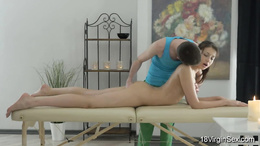 She receives seductive massage and gets her pussy fingered on table