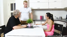 Hot young brunette gets pussy eaten and fucked by mature guy in kitchen