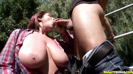 Lisa Sparxxx slides a long cock deep into her throat as she sucks it