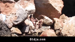 Kinky old fart and slutty brunette fucking on the beach