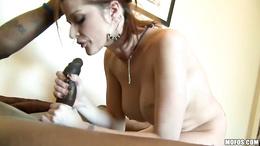 Joslyn James teases a cock harder in her mouth until she gets cummed